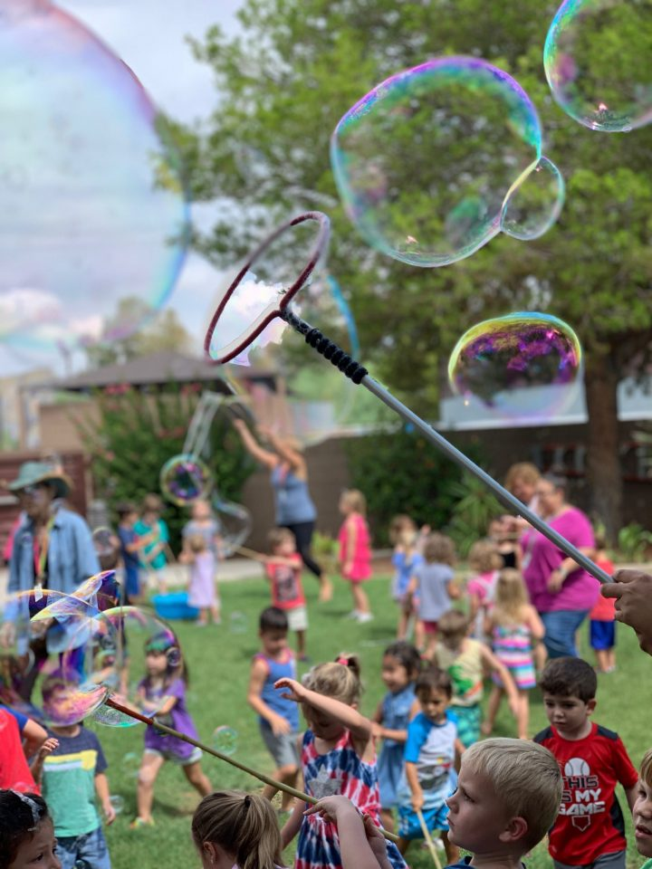 Kids playing with bubbles